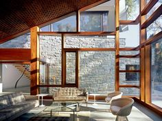 love the MIdCentury Modern pieces- platner chairs,barcelona table, knoll sofas. Love the windows and the view to the adjacent stone wing of the house