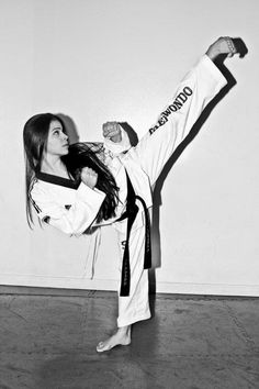 Highkick Taekwondo, perfect technique. Hands still in defensive position, upper body relaxed.