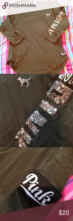 PINK olive green bling baseball tee 💎 Super cute pink olive green baseball tee. Cute style and fit. Bling logo on complete left sleeve, as well as bling dog. Bling in tact perfectly. Pink  embroidered tag at bottom left of shirt. Size L, good condition. Purchased for 46.50$ back in October. PINK Victoria's Secret Tops Blouses