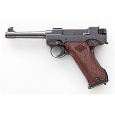 2nd Variation Lahti L-35 Semi-Automatic Pistol, #4366, 9mm, 4.7'' barrel, blue finish, brown checkered plastic grips with VKT logo, cut for shoulder stock, with rounded Loaded Chamber indicator; early narrow upper receiver marked ''VKT/L-35'' with yoke locking piece and protrusion eliminated; with etched letter ''E'' to right side of trigger and takedown Loading that magazine is a pain! Get your Magazine speedloader today! http://www.amazon.com/shops/raeind