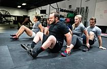 """CrossFit coaches share their favorite warm-up games to get athletes laughing and moving. """"High knees, lunges and PVC pass-throughs!"""" While lunging her way across the room for what feels like the millionth time, an athlete steals a jealous glance at the wildly giggling CrossFit Kids who are playing a tic-tac-toe racing game in the next room. At CrossFit Leverage, warm-up games aren't just for kids. """"All of our members have got real jobs and real lives outside of this place,"""" said affiliate…"""