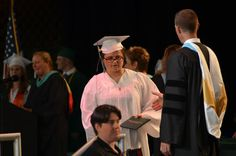 A teen with autism graduates