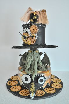 Steampunk birthday cake with mask, Cuthulhu, steampunk hat, gears clock and Bioshock Songbird on top.