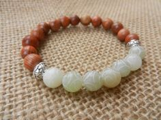 Jade carved bead bracelet with Rose wood mala beads by PureLapis