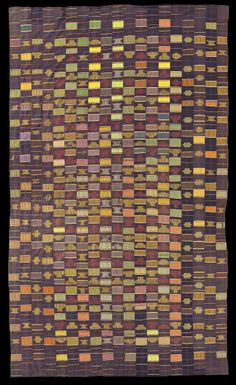 Fine mid C20th Ewe man's cloth with a purplish background created by combining a red weft with a dark blue warp. The decoration is made up of narrow weft faced stripes, wider weft faced blocks, and some relatively simple geometric supplementary weft float motifs. What interests me about this cloth is the way the weaver varied the placement, colour and density of the decoration both within each strip and across the body of the cloth as a whole to create a dynamic offbeat effect.