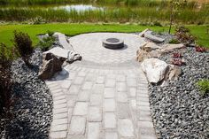 Stone Oasis Circle Firepit surrounded by Roman pavers.