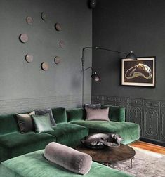Dark grey living room with green velvet sofa