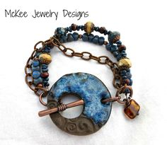 Blue and brown ceramic clasp, metal, Czech Picasso glass bracelet. Handmade jewelry, artisan jewelry, boho, bohemian, McKee Jewelry Designs, Andria McKee