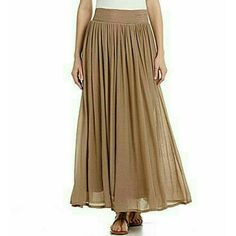 Pleated Maxi Skirt -Sand/Tan color -Never worn, still has tags -Long, flowy  Could be worn with long sleeves for colder weather, or short sleeves/sleeveless during the warm seasons. Can be dressed up or dressed down! Nurture Skirts Maxi