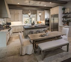 Rustic chic | Thompson custom homes. I love the dinning table and the marble floor.