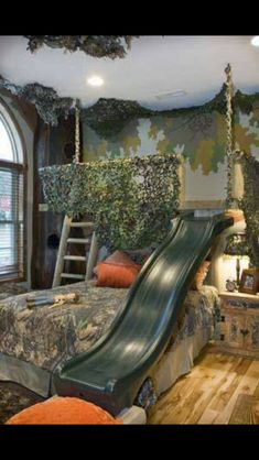 What little boy (or tomboy) wouldn't love this! A deer stand above the bed, with a slide.