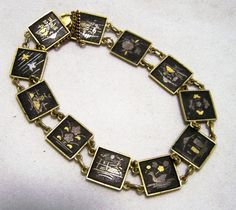 Mid Century Damascene style square panel bracelet Black background with gold and silver designs Includes flower, bird, mountain, pagoda Each square is 1/2 inch 7 7/8 inches... #gotvintage #vogueteam