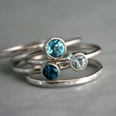 Ocean Blue Stacking Rings  A beautiful range of blues. Five handmade sterling silver stacking rings. Three smooth ring bands are set with ocean blue