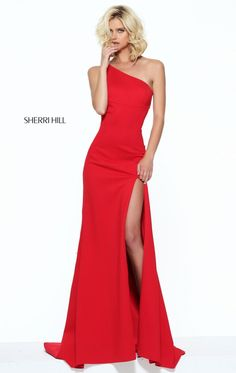 Captivate everyone in Sherri Hill 50861. Diagonal neckline creates an asymmetrical look. Cutout detail at the back is complimented with the side slit.