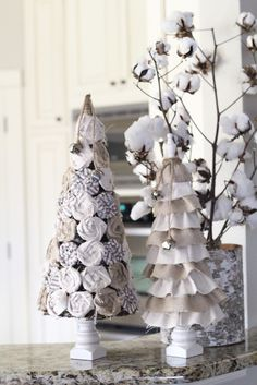 2 trees to make and both tutorials included on this site 1) Burlap, Drop Cloth & Ticking Rosettes Oh my!!! 2) Ruffles!!! Burlap & Drop Cloth ~ So cute is neutral is your thing :}