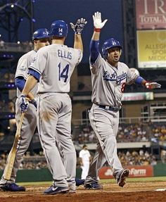 The Dodgers' Shane Victorino  right gets a high five after a home run in the 5-4 victory over the Pittsburgh Pirates on August 13, 2012.