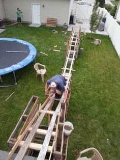 Teen Boys made their own roller coaster in back yard Backyard Camping, Backyard Playground, Backyard For Kids, Backyard Games, Backyard Patio, Backyard Landscaping, Wedding Backyard, Backyard Ideas, Homemade Roller Coaster