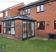 This beautiful conservatory magically matches the home with matching bricks and windows. Adds great space to any house. Small House Extensions, Renovations, Conservatory Design, Backyard Renovations, New Homes, Kitchen Extension Family Room, Home Additions, Outdoor Living Rooms, House Extensions