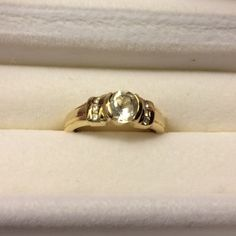 14K Glacier Topaz & White Sapphire Gold Ring Solid 14k gold ring with glacier topaz & white sapphires.  Includes certificate of authenticity. 3.74g 14K gold Jewelry Rings