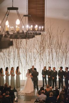 Enchanted forest inspiration of branches with hanging orchids and tea light candles created by Florals by the Sea at Rosemary Beach Town Hall.