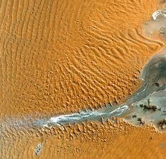 Namib Desert, Namibia – Namib-Naukluft National Park is an ecological preserve in Namibia's vast Namib Desert. Coastal winds create the tallest sand dunes in the world here, with some dunes reaching 980 feet (300 meters) in height.