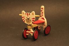 Toy cat on castors 1/12 scale for dollhouse by Ankinakia on Etsy, €50.00