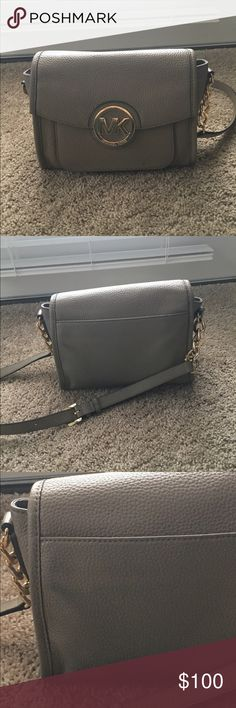 Michael Kors Crossbody Tan Used Michael Kors crossbody tan . Has some everyday wear I carried it daily. On the back there is slight blue staining from my dark jeans . I added a close up image of that . It is still in great shape . Michael Kors Bags Crossbody Bags