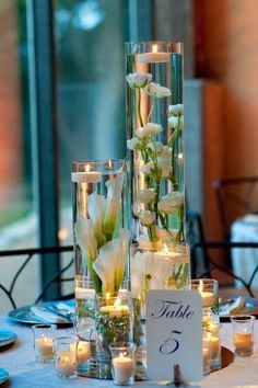 Wedding Flower Centerpieces Using White Wedding Flowers.  http://memorablewedding.blogspot.com/2014/01/wedding-flower-centerpieces-using-white.html- For more amazing finds and inspiration visit us at http://www.brides-book.com and join the VIB Ciub