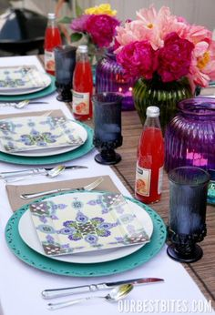 Pretty colored candy jars as vases