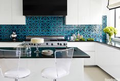 The bold tile is quite fun House of Turquoise
