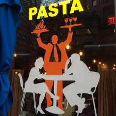 Things I like about this decal on a restaurant window: The insane orange waiter. That he's carrying his plates in the air like a strongman. The couple looks like this isn't the first time he's done this, but it's easier to just let it happen at this point. The sign says PASTA as if he's screaming it like a frankenstein. But he's holding a plate of an entire chicken and a plate of wine glasses. There's three wine glasses. One's for him.
