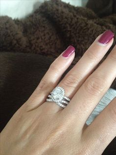 From my love ... Oval engagement ring with halo and the perfect twist band!
