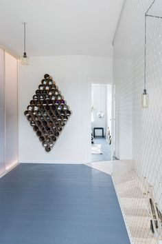 danish architecture and design studio spacon and X has recently renovated this copenhagen apartment for a family of four by merging two apartments into one. Design Apartment, Apartment Renovation, Layout, Folding Guest Bed, Copenhagen Apartment, Built In Bathtub, Built In Sofa, Appartement Design, Living Room Shelves
