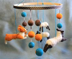 Corgi Herding Sheep - Felt Baby Mobile - Unisex - Teal/Orange/Brown.  via Etsy.