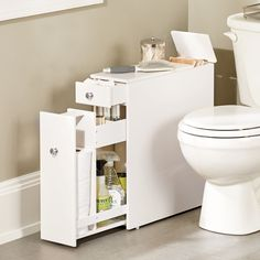 Slim bathroom cabinet fits in that un-used space between the toilet and the wall. Now that's a brilliant small space bathroom storage solution!
