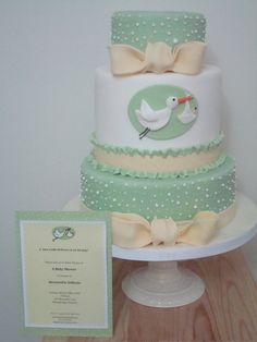 baby shower cake. green yellow, dots. ruffles and ribbon. and a stork.