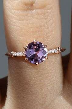 Inspired by our romantic dreams, this recycled rose gold ring is our latest masterpiece! Centered upon an enchanting firey fine Spinel this gem sparkles with vivid and rich pink and purple flair. The ring is fashioned in a glamorous and romantic Art Deco-inspired style with an elegant band. Six single eagle claw prongs hold the center stone in an antique Georgian style Collet setting.