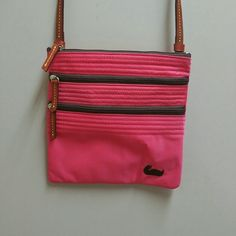 DOONEY & BOURKE NYLON AND LEATHER CROSSBODY Watermelon pink and chocolate brown zippers and duck. Inside is hot pink. 8in tall and 8 in wide. The zipper is kind of stiff...but there is no teeth missing.   Never carried. Dooney & Bourke Bags Crossbody Bags