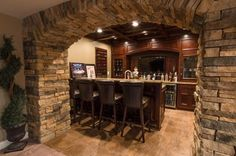 The Metzgers' basement bar, framed by the stone archway that's the centerpiece of the room.