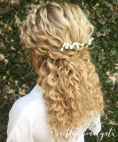 Natural curly bridal hair. Half up, half down with a braid on the side. Each curl was perfected with a small wand @caitlynbeautyatx