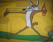 Wile E. Coyote shooting a stick of dynamite from a slingshot