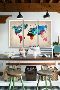 Study interior - world map watercolour canvas triptych prints from Naxart collection; timber beams, table and rustic stools; pendant lights. LOVE