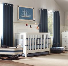 gorgeous nursery sailing theme---pretty sure this was a Restoration Hardware set-up, and I LOVE that little boat rocker :) (links to a gallery of sailboat nurseries)
