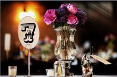 Love the plum and fuchsia colors and the wedding table number font.