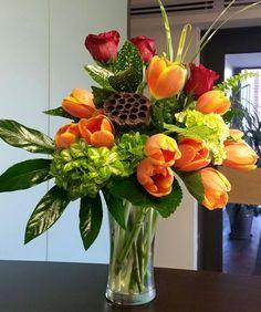 Green hydrangeas, orange tulips & red roses vase arrangement