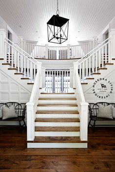 Muskoka Living |-Tradewinds in Muskoka Ontario, gorgeous trim and stair detail, white with wood, board ceiling