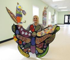 Cool group art project. Large mosaic with individually painted pieces.