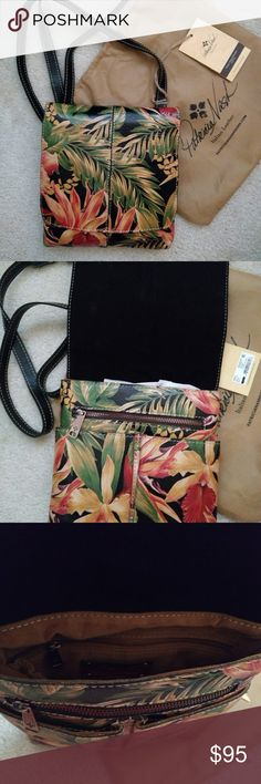 """Patricia Nash Granada Crossbody Purse NWT Patricia Nash """"Grannada"""" Black Cuban Tropical Floral Italian Leather Crossbody Handbag MSRP $129    Beautifully Handcrafted Italian Leather. Flap closure; Crossbody strap is adjustable to several lengths. Vintage crinkle look to the leather; supple and beautifully printed in a bright tropical floral theme.   Hibiscus flowers cover the front of the bag.  Pictures are of the bag up for sale.  Spacious inside with multiple compartments.  Patricia Nash…"""