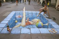 Sidewalk chalk Swimming Pool by Julian Beever - Julian Beever is an English artist of Chalk art (Art with chalk) that creates three-dimensional drawings using chalk as material. also: http://leiovejoopino.blogspot.com/2010/02/julian-beever.html