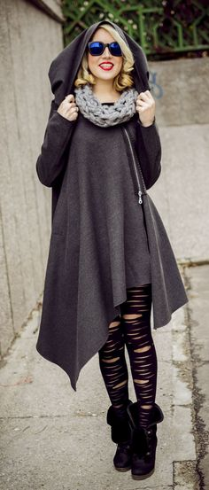 Asymmetrical wool hooded coat with lateral metal zip closure. Loose extravagant wool coat. Large hood and lateral pocket. No lining. Material: 30% wool,